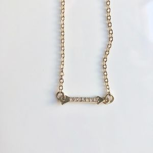 URBAN OUTFITTERS: GOLD/CRYSTAL ARROW NECKLACE